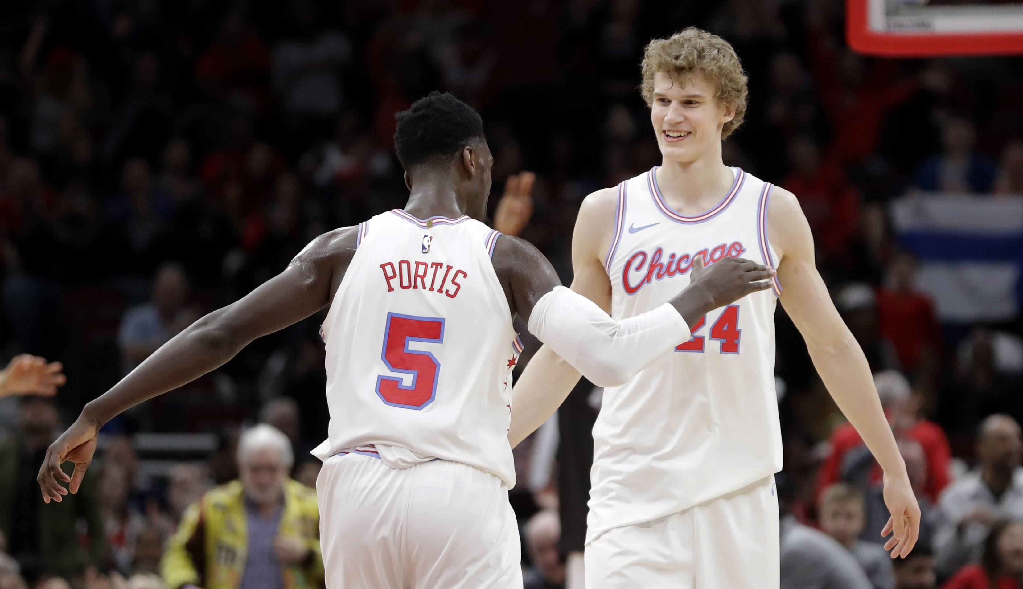 Chicago Bulls' Bobby Portis (5) and Lauri Markkanen celebrates Markkanen's clutch score late in the second half of an NBA basketball game against the Dallas Mavericks, Friday, March 2, 2018, in Chicago.
