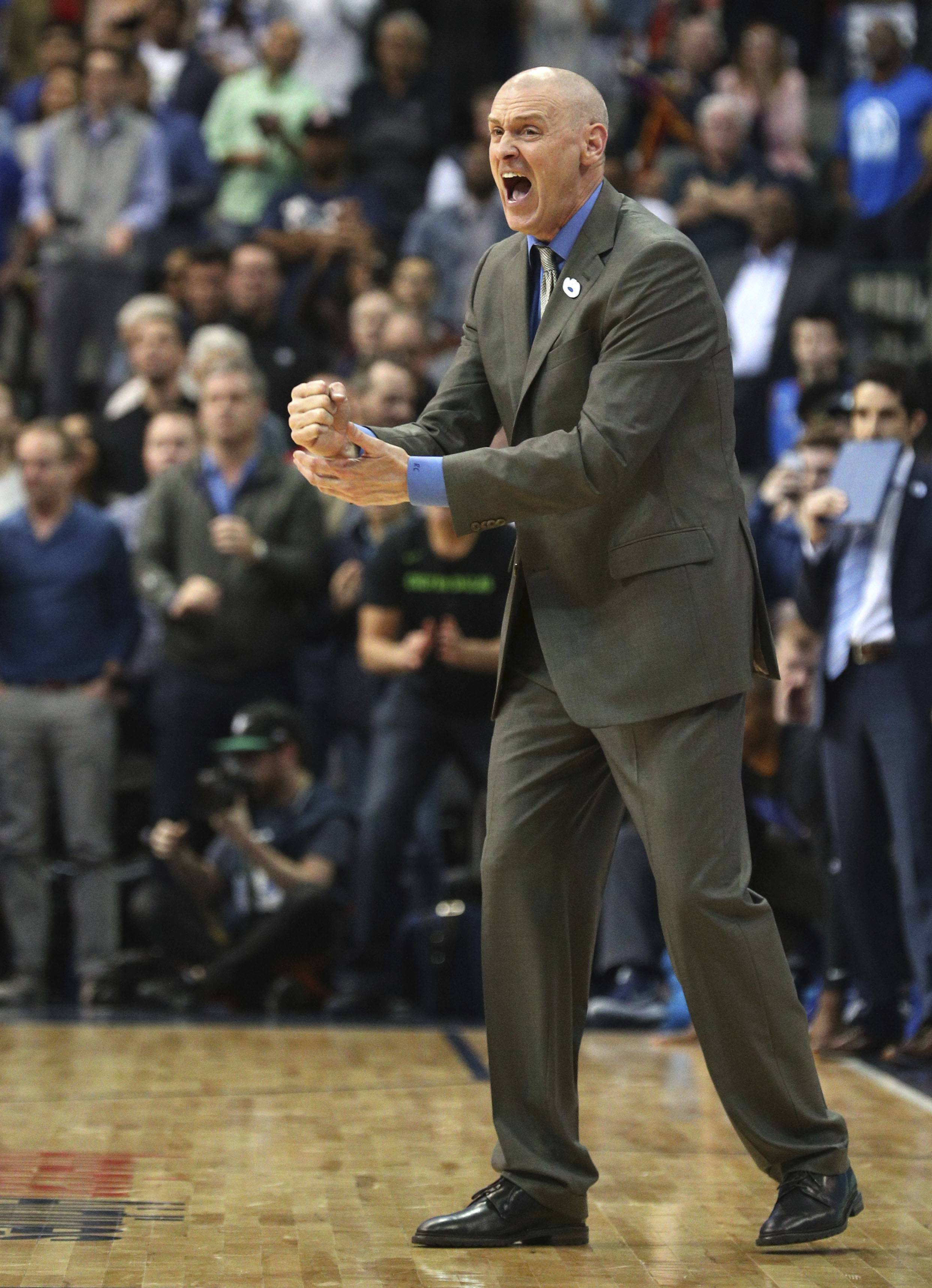 Dallas Mavericks coach Rick Carlisle steps onto the court during overtime of the team's NBA basketball game against the Oklahoma City Thunder on Wednesday, Feb. 28, 2018, in Dallas.