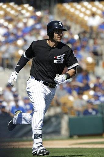 Chicago White Sox's Nicky Delmonico runs to first during the second inning of a spring training baseball game against the Los Angeles Dodgers, Friday, March 2, 2018, in Glendale, Ariz.