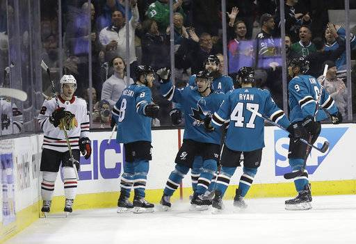 San Jose Sharks' Joe Pavelski, second from left, celebrates his goal with teammates during the first period of an NHL hockey game against the Chicago Blackhawks, Thursday, March 1, 2018, in San Jose, Calif.