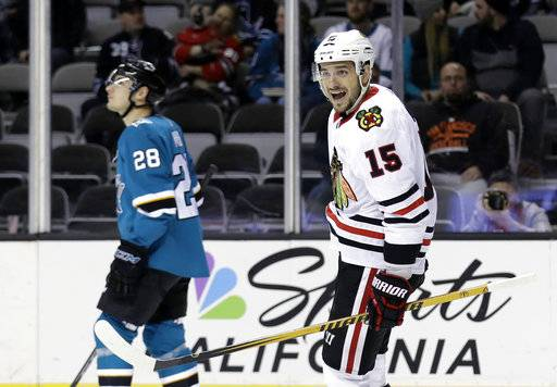 Chicago Blackhawks' Artem Anisimov (15) celebrates after scoring against the San Jose Sharks during the first period of an NHL hockey game Thursday, March 1, 2018, in San Jose, Calif.