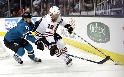 Chicago Blackhawks' Patrick Sharp (10) is defended by San Jose Sharks' Joakim Ryan (47) during the first period of an NHL hockey game Thursday, March 1, 2018, in San Jose, Calif.