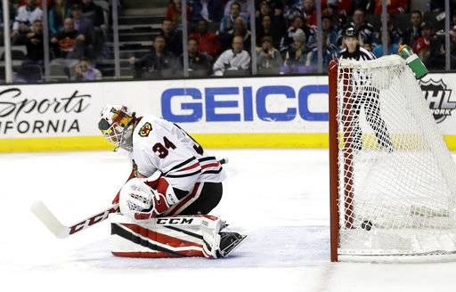 Chicago Blackhawks goalie Jean-Francois Berube gives up a goal to San Jose Sharks' Timo Meier during the second period of an NHL hockey game Thursday, March 1, 2018, in San Jose, Calif.