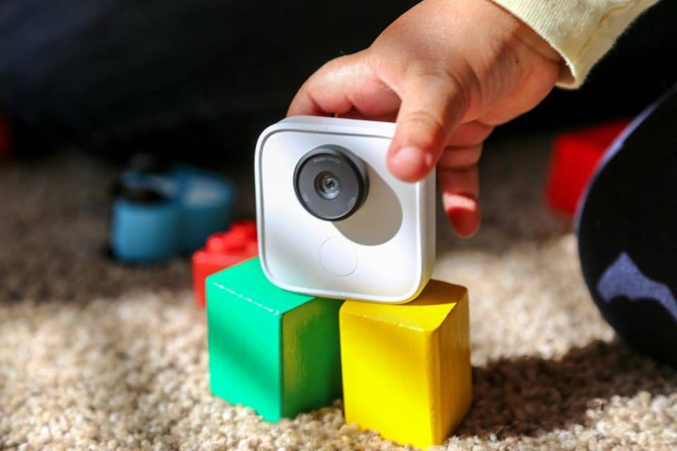 A baby plays with the Google Clips camera.