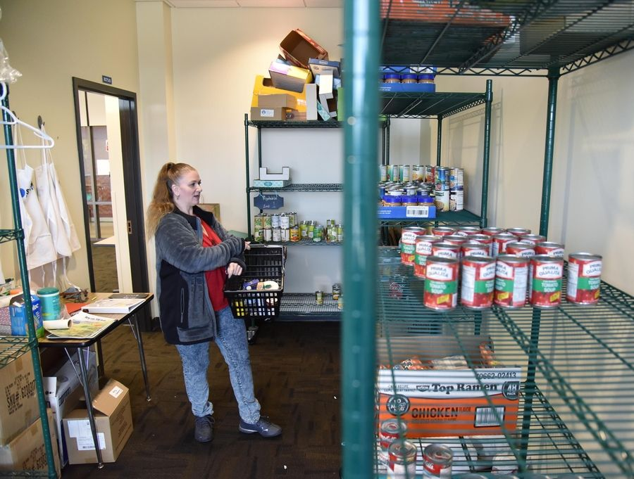 Angela, an Elgin Community College student, is among dozens of students who use the college's food pantry. Students who qualify can visit twice weekly.