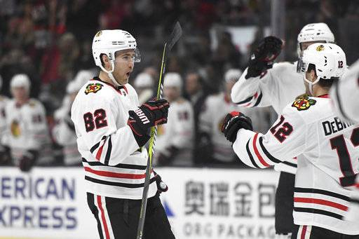 Chicago Blackhawks defenseman Jordan Oesterle (82) reacts after scoring a first-period goal during an NHL hockey game against the Los Angeles Kings, Saturday, March 3, 2018, in Los Angeles.
