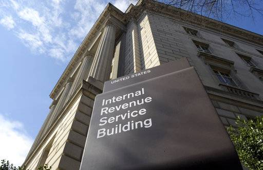 The Internal Revenue Service released a new tool Wednesday designed to help millions of Americans ensure they're not dramatically underpaying or overpaying their taxes under the new Republican tax law.