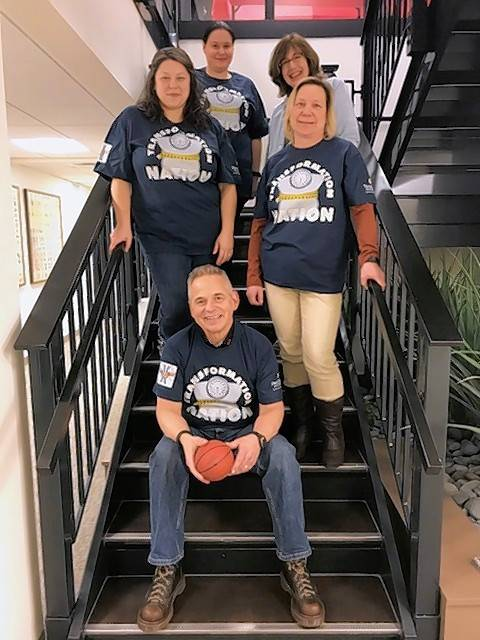Team Transformation Nation's Greg Belback, Nancy Biggio, Donita Ontiveros, Tatiana Gutierrez, and Cate Wurzer display their team spirit with custom shirts.