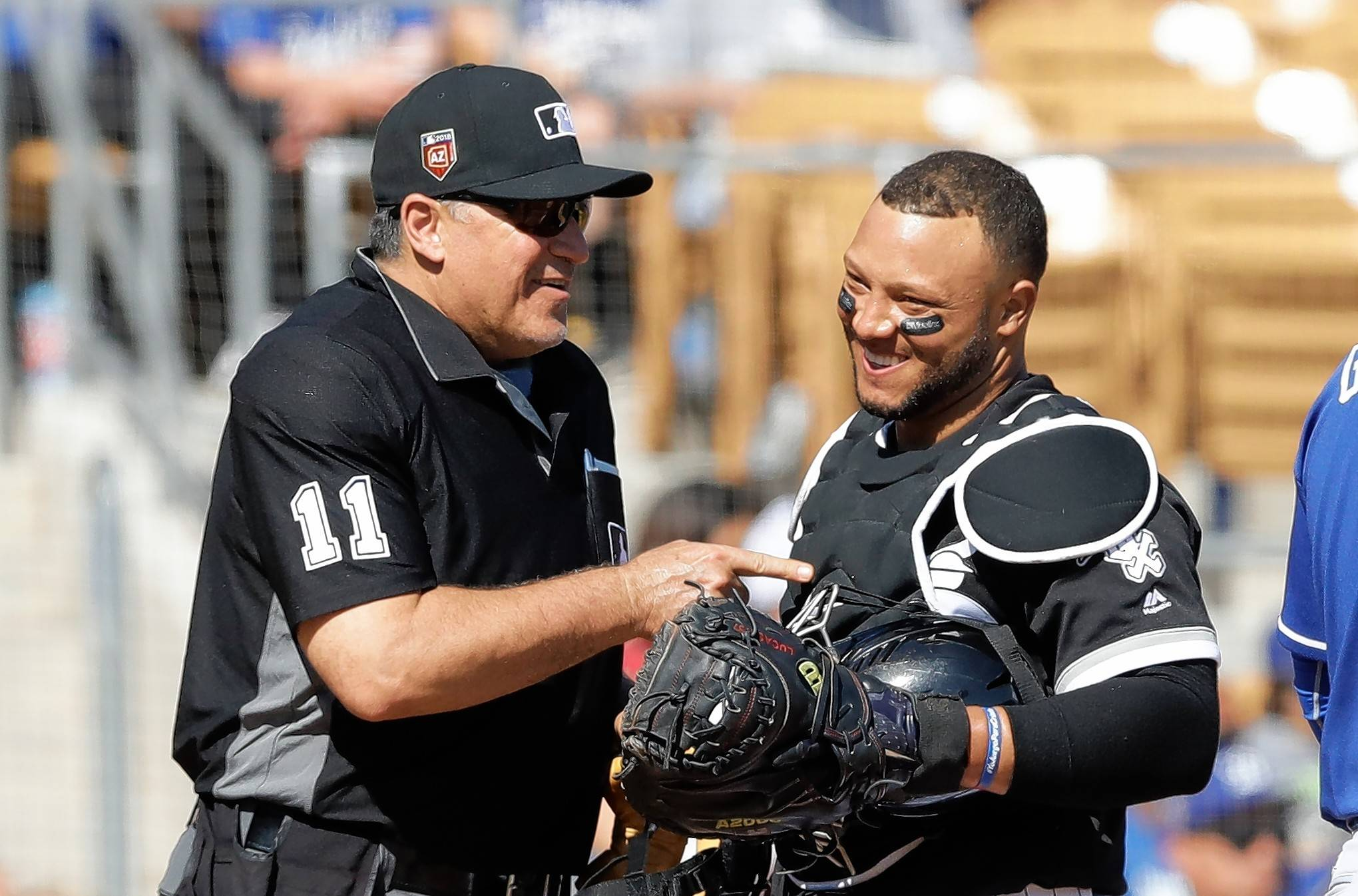 Home plate umpire Tony Randazzo talks with Chicago White Sox catcher Welington Castillo during the third inning of a spring training baseball game, Friday, March 2, 2018, in Glendale, Ariz.
