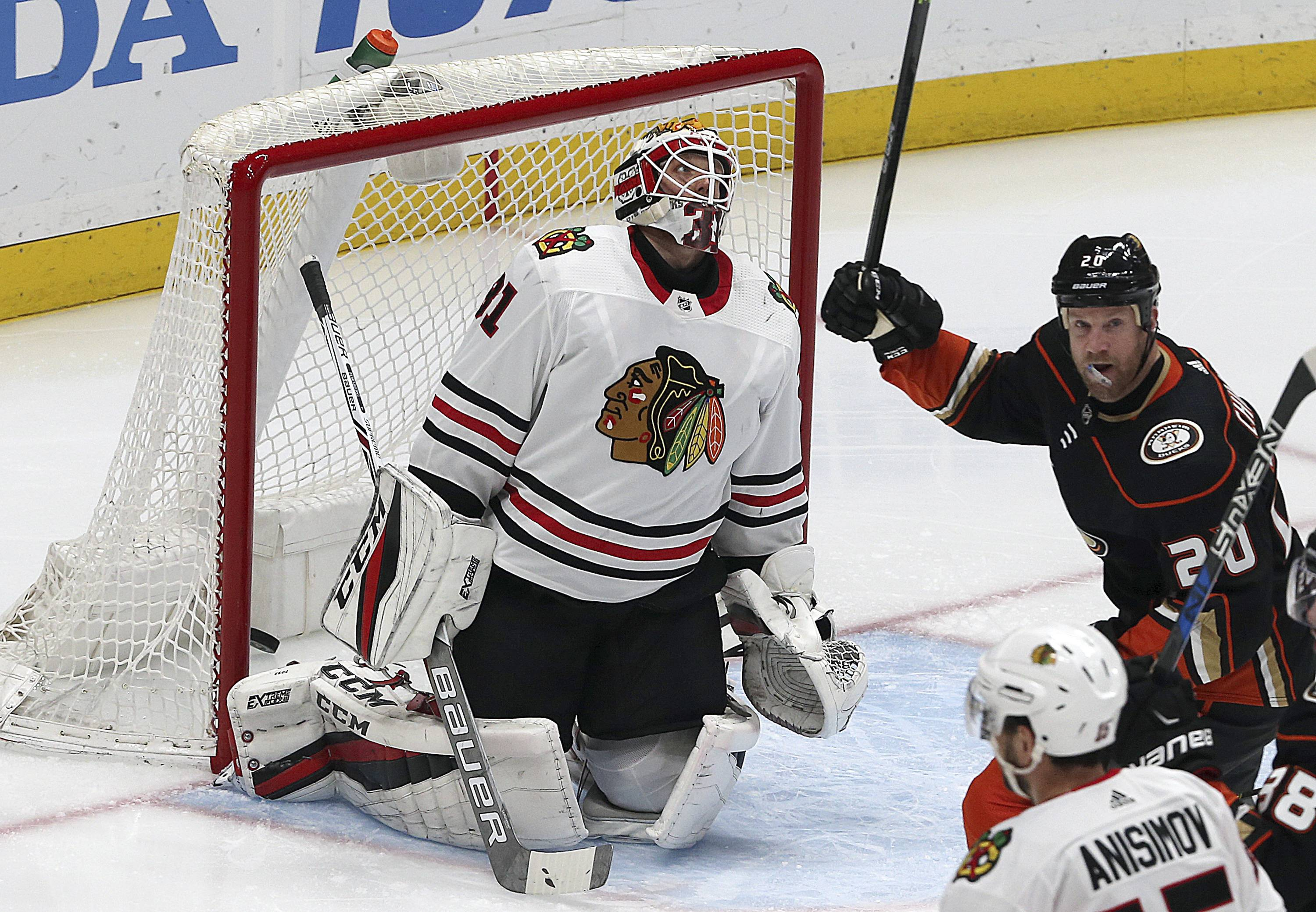 Anaheim Ducks left winger Jason Chimera (20) celebrates a goal by defenseman Marcus Pettersson (not shown) past Chicago Blackhawks goalie Anton Forsberg (31) in the second period of an NHL hockey game in Anaheim, Calif., Sunday, March 4, 2018.