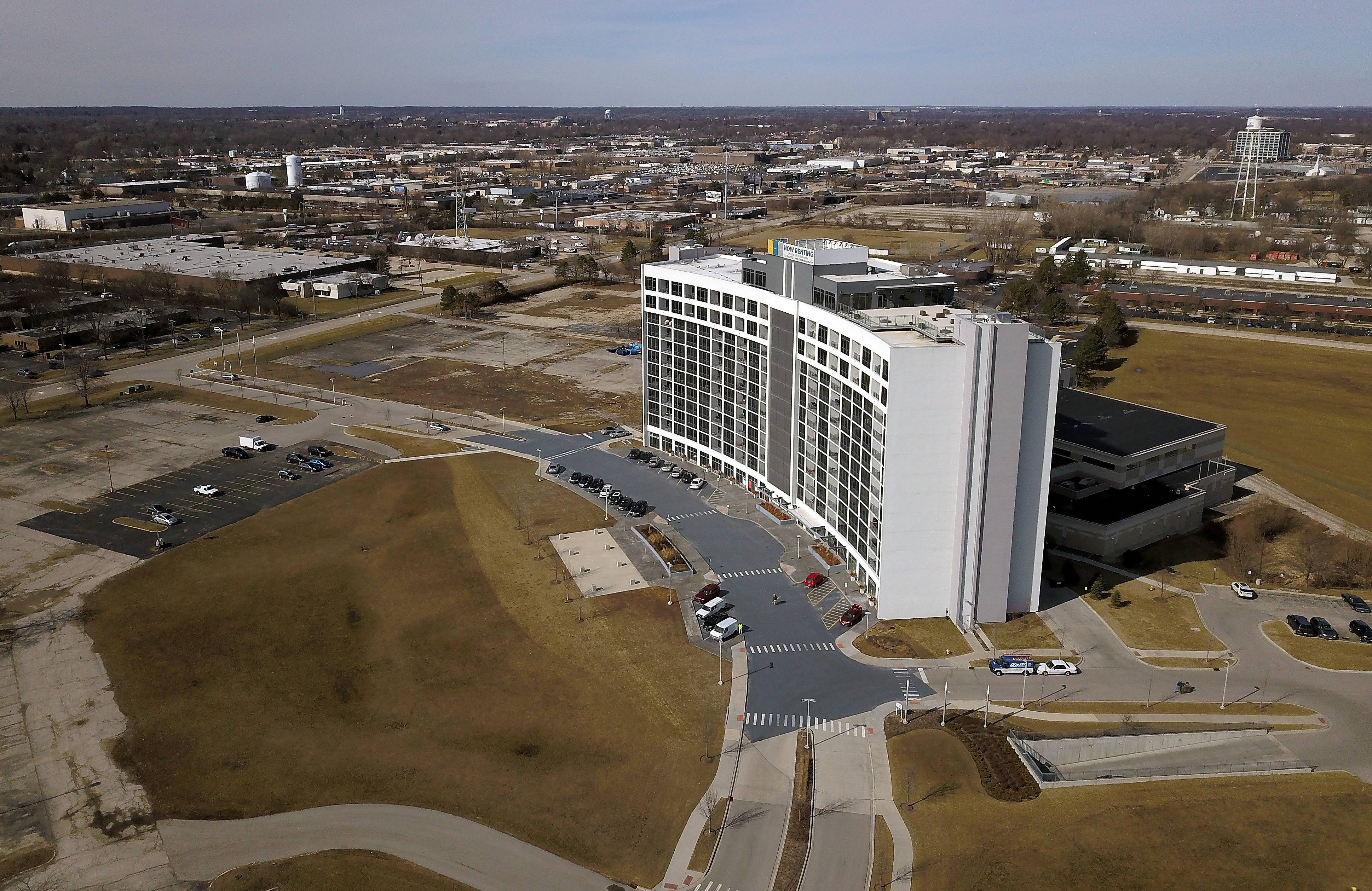 The 27-acre Arlington Downs development in Arlington Heights now only includes the One Arlington residential tower, but developers have plans for a hotel, retail and additional apartments and senior housing.