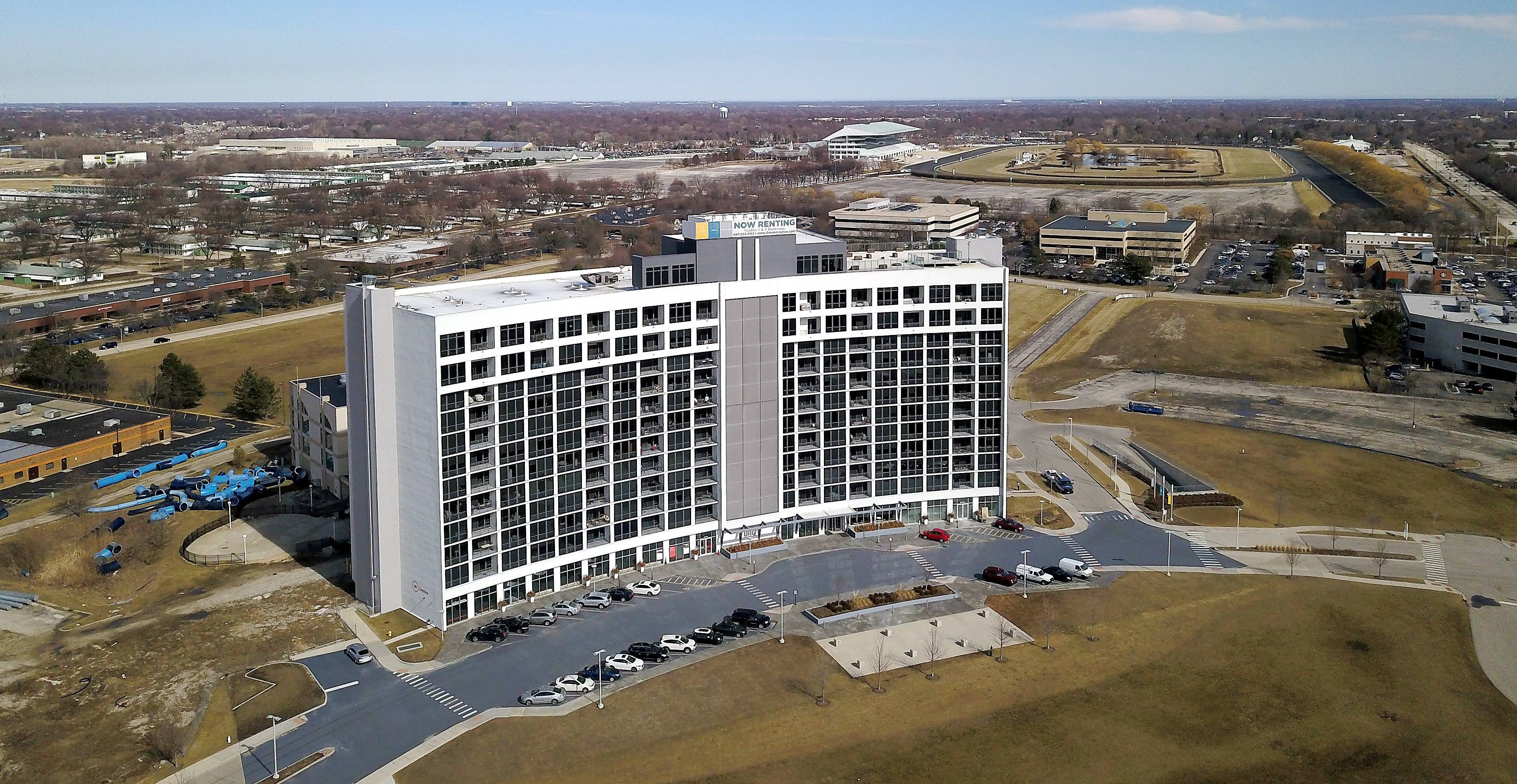 The Arlington Downs development, anchored by the One Arlington residential tower, has been slow to develop, prompting developers to revise their plans to try to get the rest of the project off the ground.