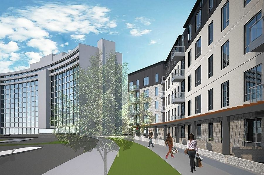 A rendering shows a proposed 5-story, 263-unit residential building, right, to be constructed next to the existing One Arlington residential tower at the Arlington Downs development.
