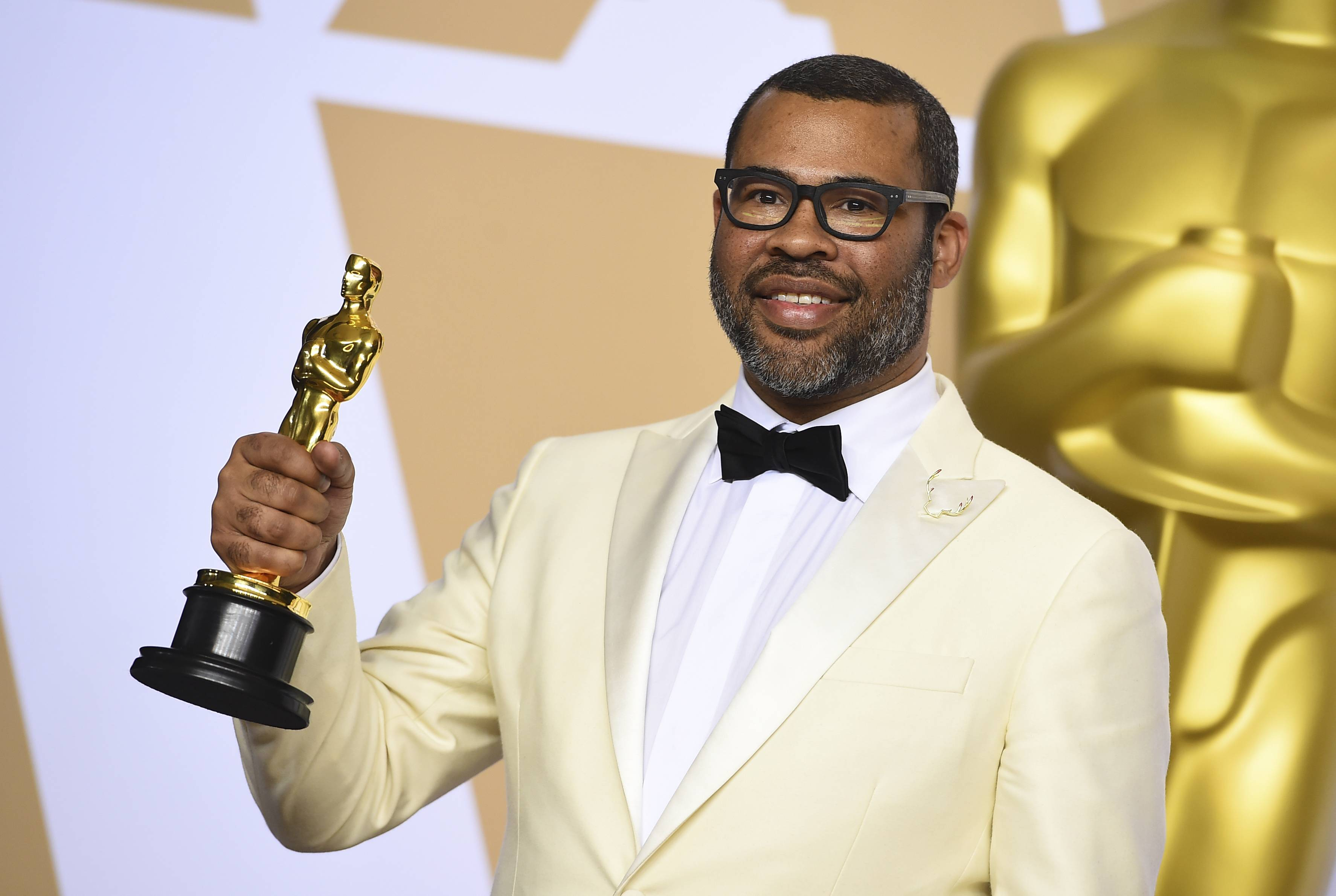 "Jordan Peele, winner of the award for best original screenplay for ""Get Out,"" poses in the press room at the Oscars on Sunday, March 4."