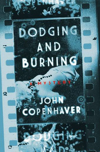 "This book cover image released by Pegasus Books shows ""Dodging and Burning,"" by John Copenhaver. (Pegasus Books via AP)"