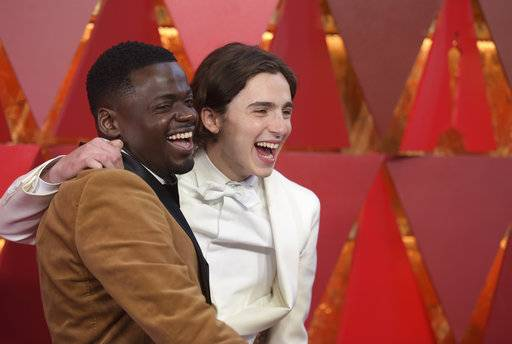 Daniel Kaluuya, left, and Timothée Chalamet arrive at the Oscars on Sunday, March 4, 2018, at the Dolby Theatre in Los Angeles. (Photo by Richard Shotwell/Invision/AP)