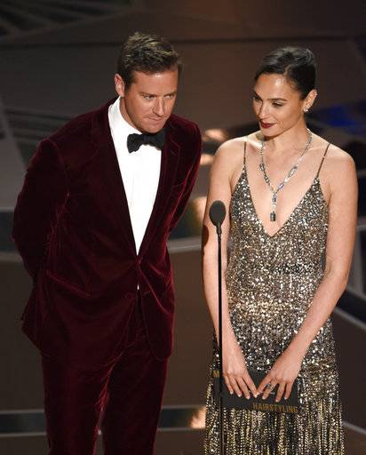Armie Hammer, left, and Gal Gadot present the award for best makeup and hairstyling at the Oscars on Sunday, March 4, 2018, at the Dolby Theatre in Los Angeles. (Photo by Chris Pizzello/Invision/AP)
