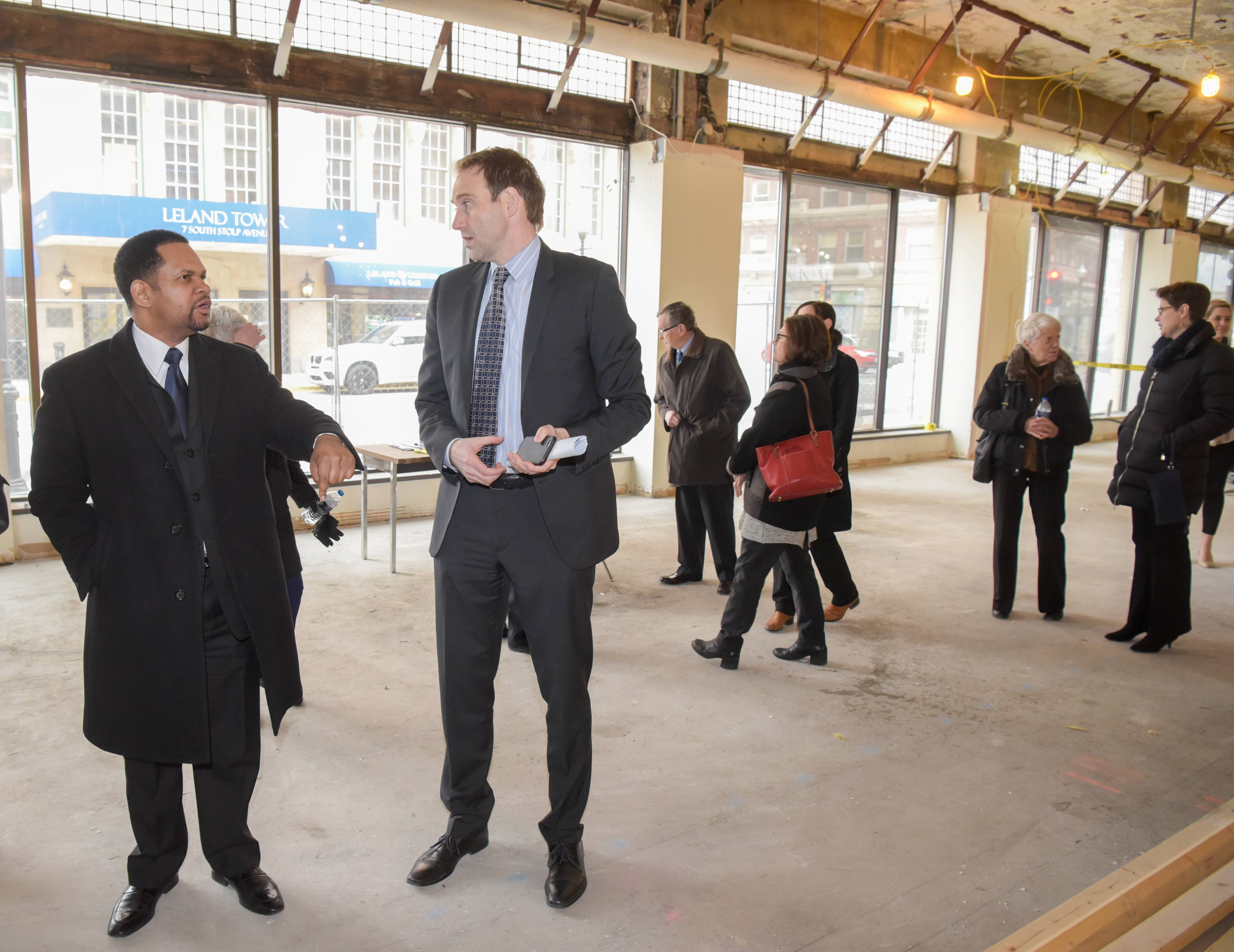 Aurora Mayor Richard Irvin, left, tours the future John C. Dunham Aurora Arts Center on Monday as construction begins on a $35 million project to turn the building next to the Paramount Theatre into a rehearsal space, arts education center, restaurant and apartments for artists.