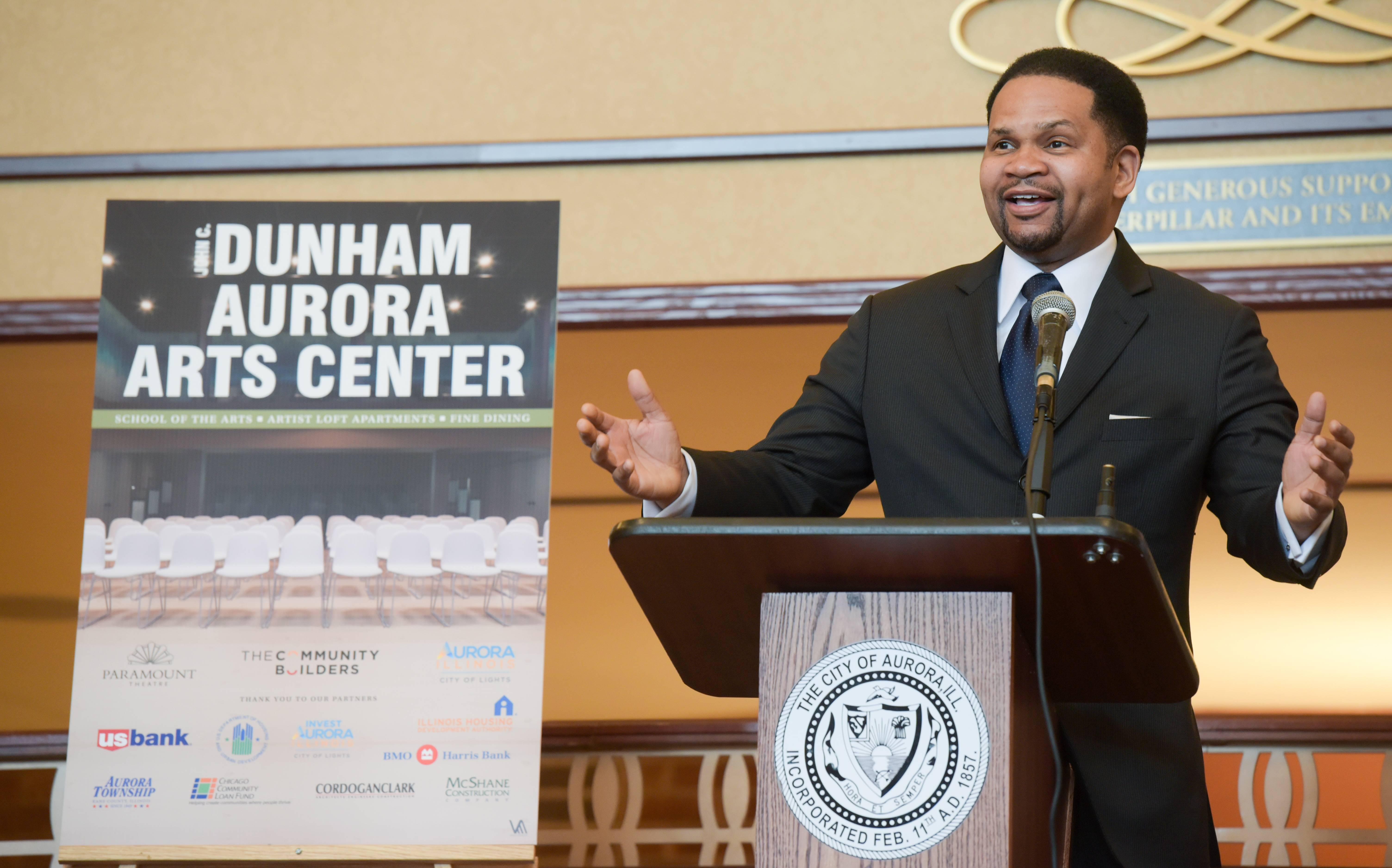 "Aurora Mayor Richard Irvin says the new John C. Dunham Aurora Arts Center, a performing arts school and Paramount Theatre rehearsal space with a restaurant and housing for artists, will be a ""domino"" that spurs downtown revival."