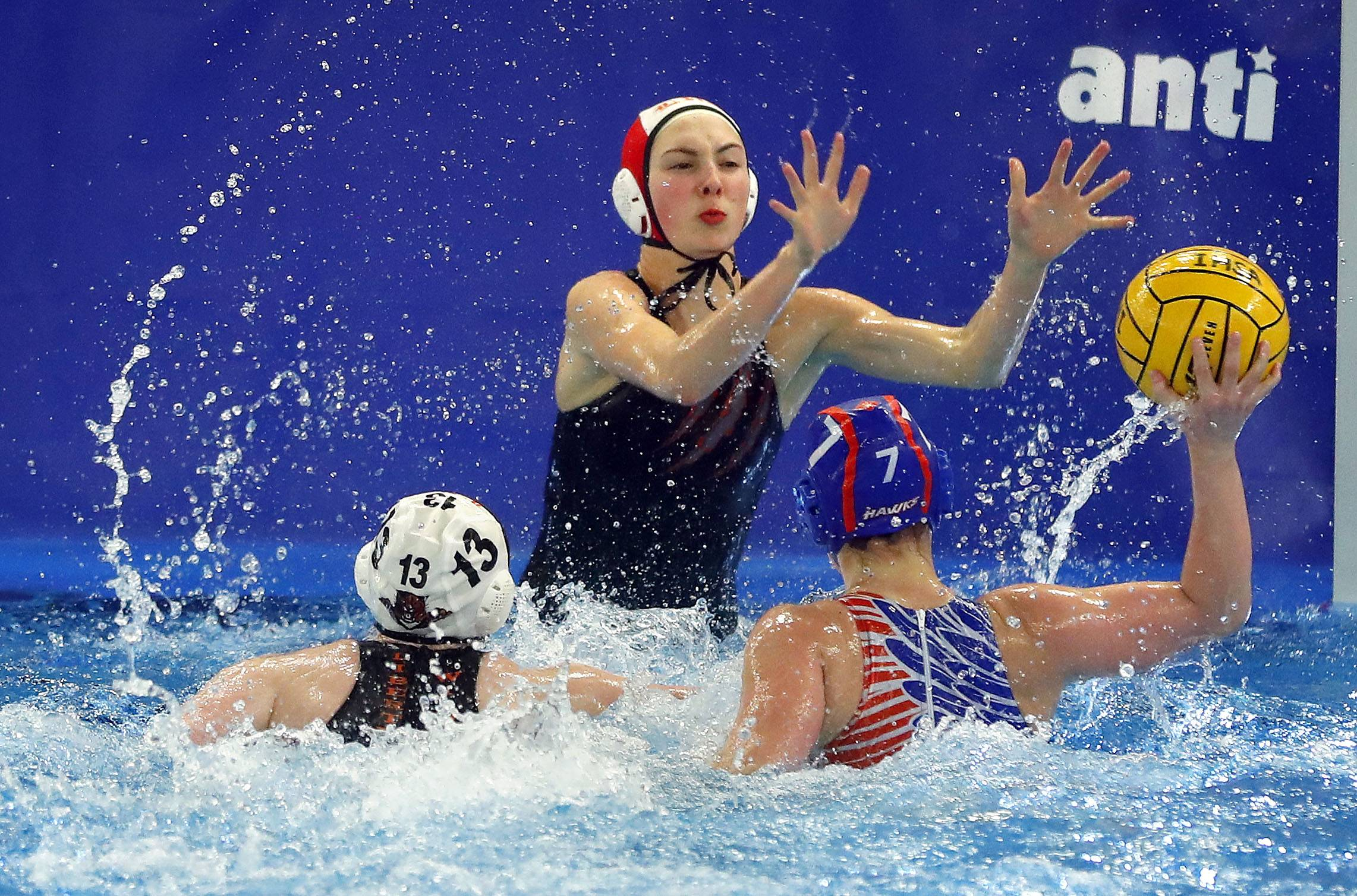Hoffman Estates' Abigail Fuscone (7) shoots on Libertyville goalie Katie DeAcetis during girls water polo action Monday at Hoffman Estates.