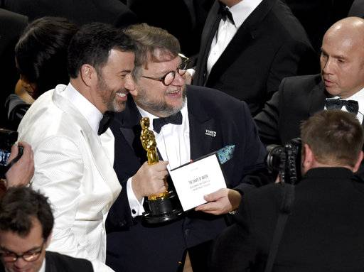 "Jimmy Kimmel, left, congratulates Guillermo del Toro in the audience after winning the award for best picture for ""The Shape of Water"" at the Oscars on Sunday, March 4, 2018, at the Dolby Theatre in Los Angeles. (Photo by Chris Pizzello/Invision/AP)"