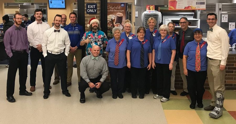 Started as a modest attempt to start the week in a professional mood, the Geneva High School's necktie club sometimes welcomes guests, such as this celebration of National Cookie Day with the lunchroom staff.