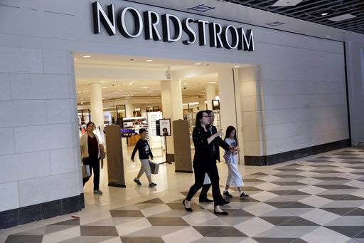 "In this Aug. 23, 2017, photo, shoppers exit a Nordstrom store in San Jose, Calif. Department store operator Nordstrom said Monday, March 5, 2018, it had rejected a takeover offer from members of the Nordstrom family, calling the price ""inadequate.� (AP Photo/Marcio Jose Sanchez)"