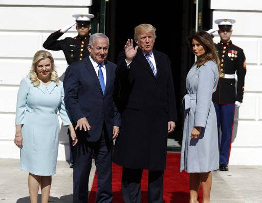 President Donald Trump and first lady Melania Trump meet with Israeli Prime Minister Benjamin Netanyahu and his wife Sara Netanyahu as they arrive at the White House, Monday, March 5, 2018, in Washington. (AP Photo/Evan Vucci)