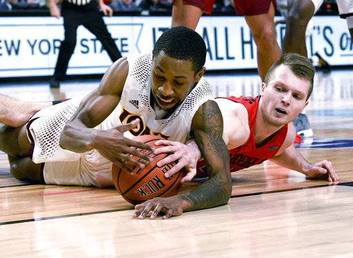 Iona guard Rickey McGill, left, and Fairfield Stags guard Aidas Kavaliauskas chase a loose ball during the first half of an NCAA college basketball game in the championship of the Metro Atlantic Athletic Conference tournament Monday, March 5, 2018, in Albany, N.Y. (AP Photo/Hans Pennink)