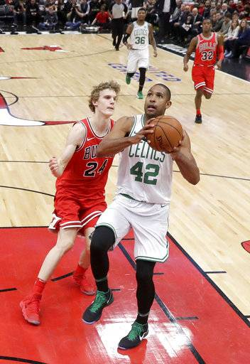 Boston Celtics' Al Horford (42) drives past Chicago Bulls' Lauri Markkanen during the first half of an NBA basketball game Monday, March 5, 2018, in Chicago.