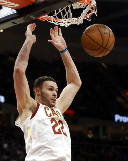 Cleveland Cavaliers' Larry Nance Jr. dunks the ball against the Detroit Pistons in the first half of an NBA basketball game, Monday, March 5, 2018, in Cleveland. (AP Photo/Tony Dejak)
