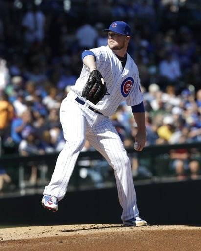 Chicago Cubs starting pitcher Jon Lester throws during the first inning of a spring training baseball game against the Chicago White Sox, Tuesday, Feb. 27, 2018, in Mesa, Ariz.