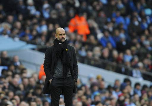 Manchester City manager Josep Guardiola looks during the English Premier League soccer match between Manchester City and Chelsea at the Etihad Stadium in Manchester, England, Sunday, March 4, 2018. (AP Photo/Rui Vieira)