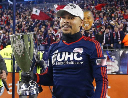 "FILE - In this Nov. 24, 2014, file photo, New England Revolution's Charlie Davies holds the MLS Eastern Conference Champion's Cup as he celebrates after a soccer match against the New York Red Bulls, in Foxborough, Mass. American forward Charlie Davies, whose career was derailed by a car crash in 2009, is retiring from soccer at age 31. In a video statement on his Twitter account Friday, March 2, 2018, Davies says ""I've loved every second of my time on the field, even the desperate lows of injury and cancer that eventually made the highs all that much sweeter."" (AP Photo/Elise Amendola, File)"