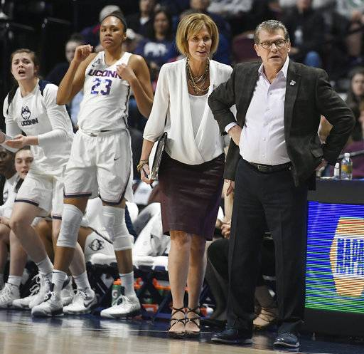 Connecticut head coach Geno Auriemma and associate head coach Chris Dailey look at an official during the first half of an NCAA college basketball game against Tulane in the American Athletic Conference tournament quarterfinals at Mohegan Sun Arena, Sunday, March 4, 2018, in Uncasville, Conn. (AP Photo/Jessica Hill)