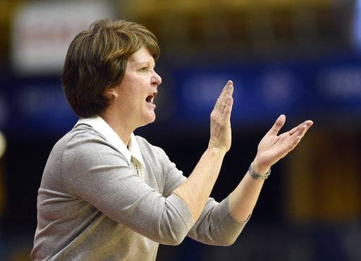 Mercer head coach Susie Gardner cheers on her team in the second half of an NCAA college basketball game against East Tennessee State in the Southern Conference tournament championship on Sunday, March 4, 2018, in Asheville, N.C. (AP Photo/Kathy Kmonicek)