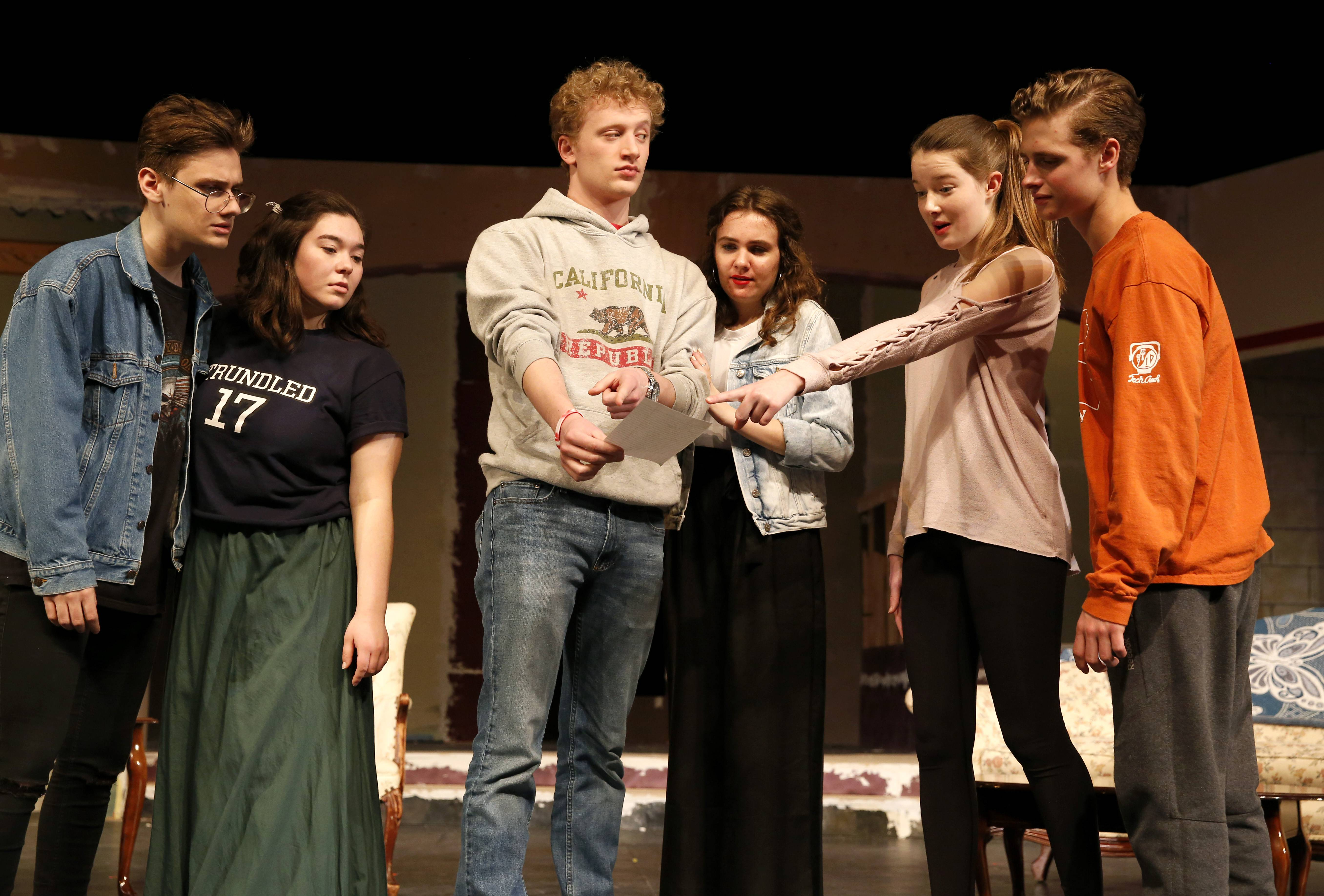 "Student actors at Naperville Central High School, including Josh Anstrand, Peri Griffiths, Alex Jech, Bailey Bergquist, Lauren Gilfillan and Payton Nesci, rehearse for ""The Game's Afoot."" The show takes center stage at 7:30 p.m. Thursday, Friday and Saturday in the school's auditorium."