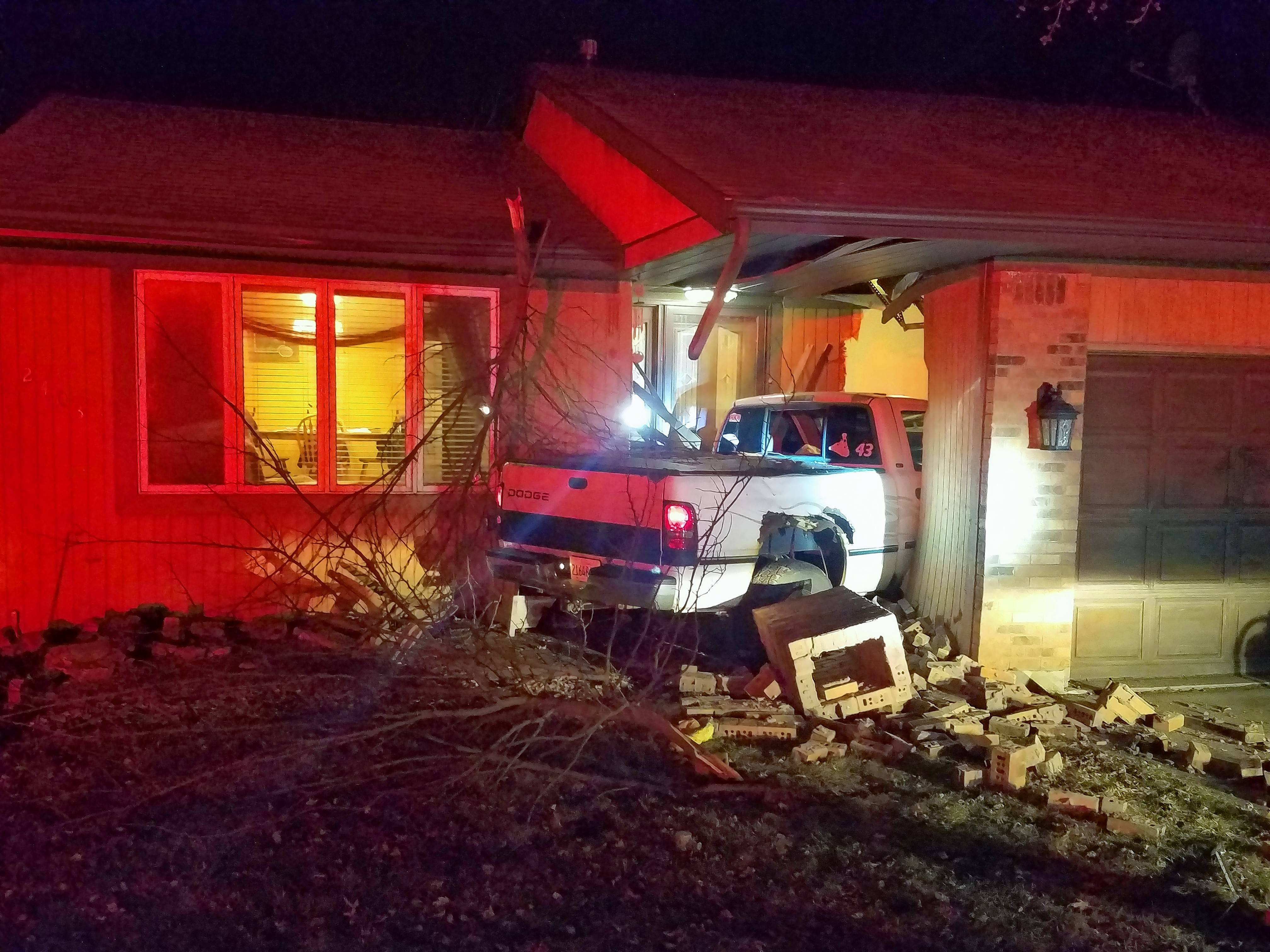 A Holiday Hills man was awakened by a loud boom early Sunday when a pickup truck crashed into his garage.