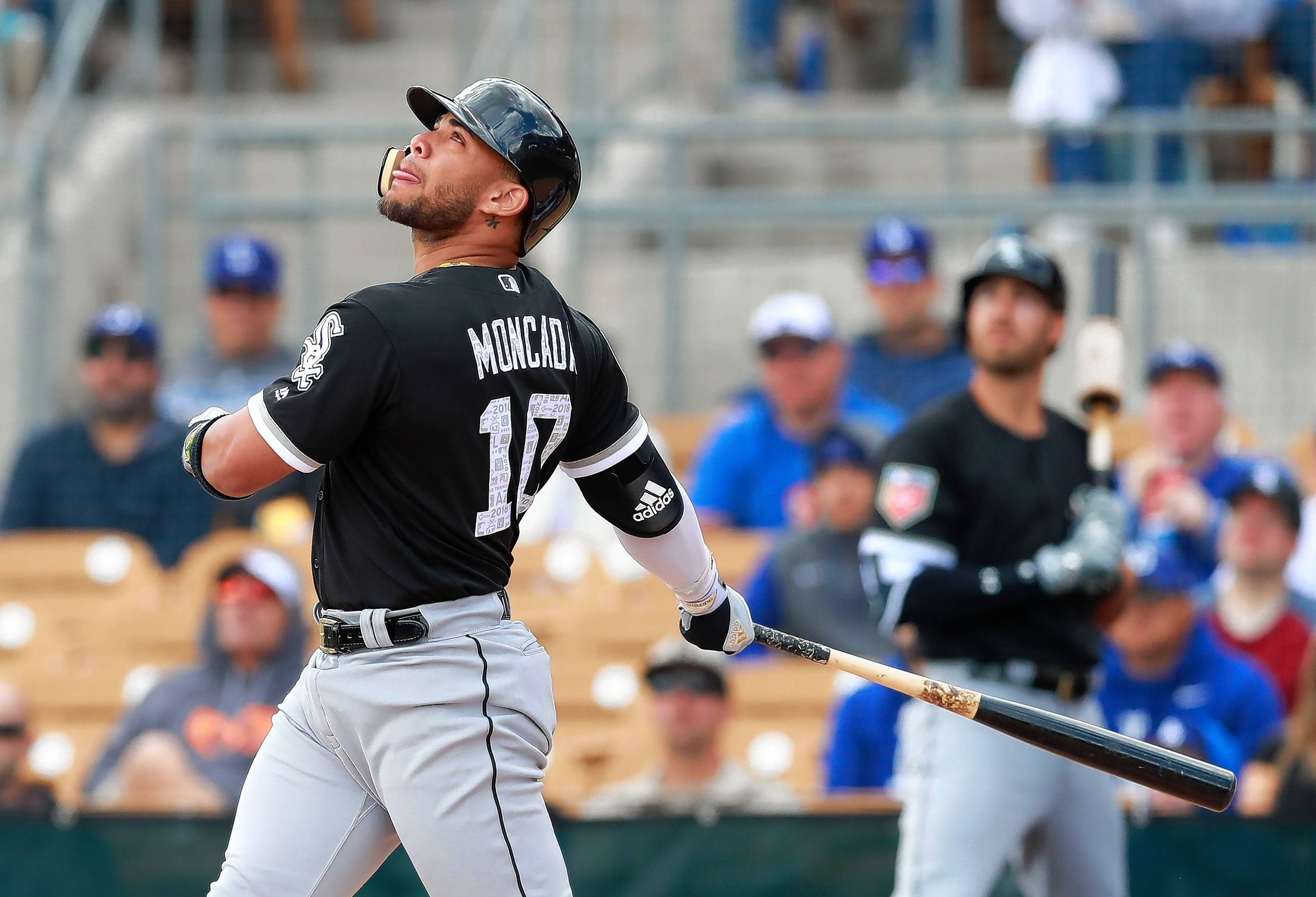 Chicago White Sox second baseman Yoan Moncada bats during a baseball spring exhibition game against the Los Angeles Dodgers, Friday, Feb. 23, 2018, in Glendale, Ariz.