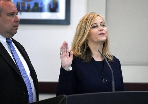 Nashville Mayor Megan Barry pleads guilty Tuesday, March 6, 2018, to felony theft of property over $10,000 related to her affair with former police bodyguard Sgt. Rob Forrest at the Justice A. A. Birch Building in Nashville, Tenn.  Barry has resigned after admitting she had an extramarital affair with her lead bodyguard and shortly after pleading guilty to a felony theft charge.  (Shelley Mayes/The Tennessean via AP)