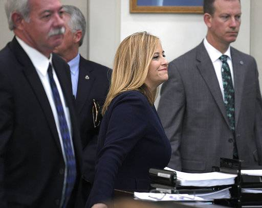 Nashville Mayor Megan Barry smiles at Judge Monte D. Watkins after pleading guilty to theft of property over $10,000 related to her affair with former police bodyguard Sgt. Rob Forrest at the Justice A. A. Birch Building in Nashville, Tenn on Tuesday, March 6, 2018.  Barry has resigned after admitting she had an extramarital affair with her lead bodyguard and shortly after pleading guilty to a felony theft charge.  (Shelley Mayes/The Tennessean via AP)