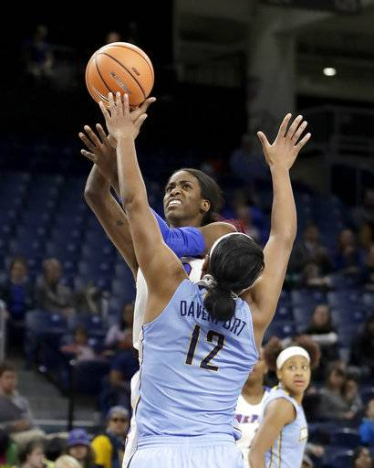 DePaul's Chante Stonewall shoots over Marquettes' Erika Davenport (12) during the first half of an NCAA college basketball game in the championship of the Big East conference tournament, Tuesday, March 6, 2018, in Chicago.