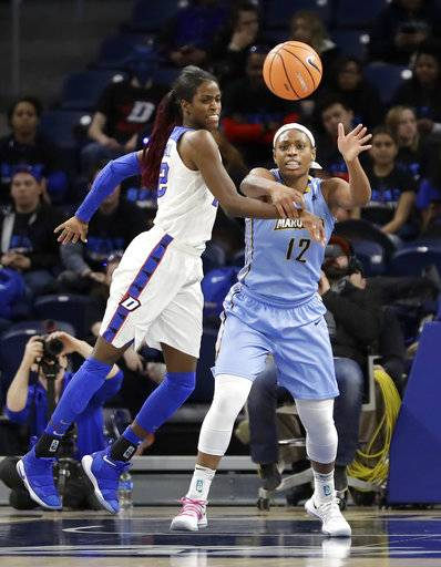DePaul's Chante Stonewall (22) knocks away a pass intended for Marquettes' Erika Davenport (12) during the first half of an NCAA college basketball game in the championship of the Big East conference tournament, Tuesday, March 6, 2018, in Chicago.