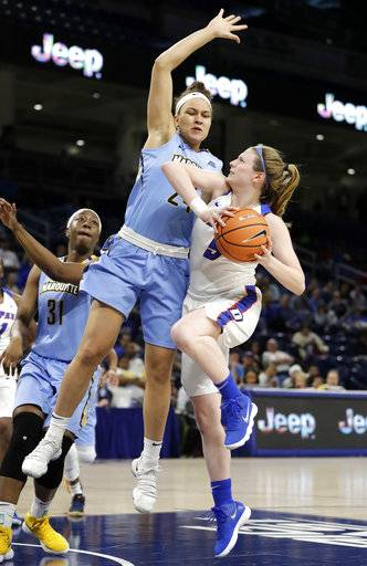 DePaul's Lauren Prochaska (5) drives on Marquette's Selena Lott (24) during the first half of an NCAA college basketball game in the championship of the Big East conference tournament, Tuesday, March 6, 2018, in Chicago.
