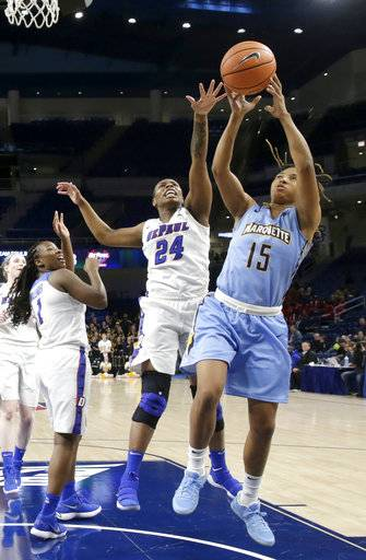 DePaul's Tanita Allen (24) knocks the ball out of Marquette's Amani Wilborn (15) hands during the first half of an NCAA college basketball game in the championship of the Big East conference tournament, Tuesday, March 6, 2018, in Chicago.