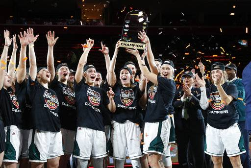 Green Bay players celebrate with the trophy after defeating Wright State 62-44 in an NCAA college basketball game in the Horizon League conference tournament championship in Detroit, Tuesday, March 6, 2018.
