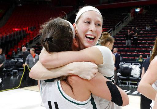 Green Bay guard Allie LeClaire, right, celebrates with Green Bay guard Caitlyn Hibner (4) after beating Wright State 62-44 in an NCAA college basketball game in the Horizon League conference tournament championship in Detroit, Tuesday, March 6, 2018.
