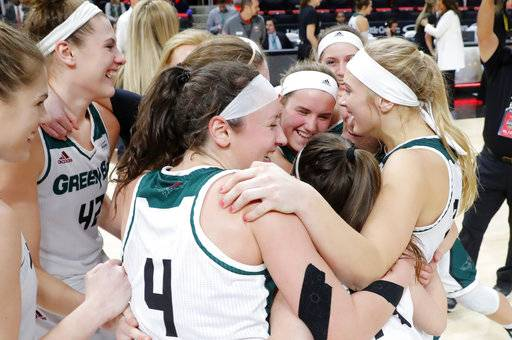 Green Bay players celebrate beating Wright State 62-44 after an NCAA college basketball game in the Horizon League Conference tournament championship in Detroit, Tuesday, March 6, 2018.