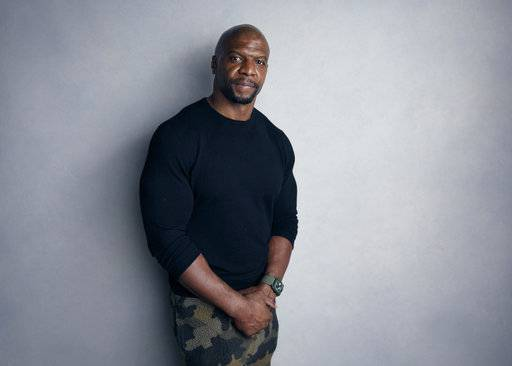 "FILE - In this Jan. 21, 2018, file photo, Terry Crews poses for a portrait to promote the film, ""Sorry to Bother You"", at the Music Lodge during the Sundance Film Festival in Park City, Utah. Prosecutors on Wednesday, March 7, decided not to file charges against a talent agent whom Crews said groped him at a Hollywood party. (Photo by Taylor Jewell/Invision/AP, File)"