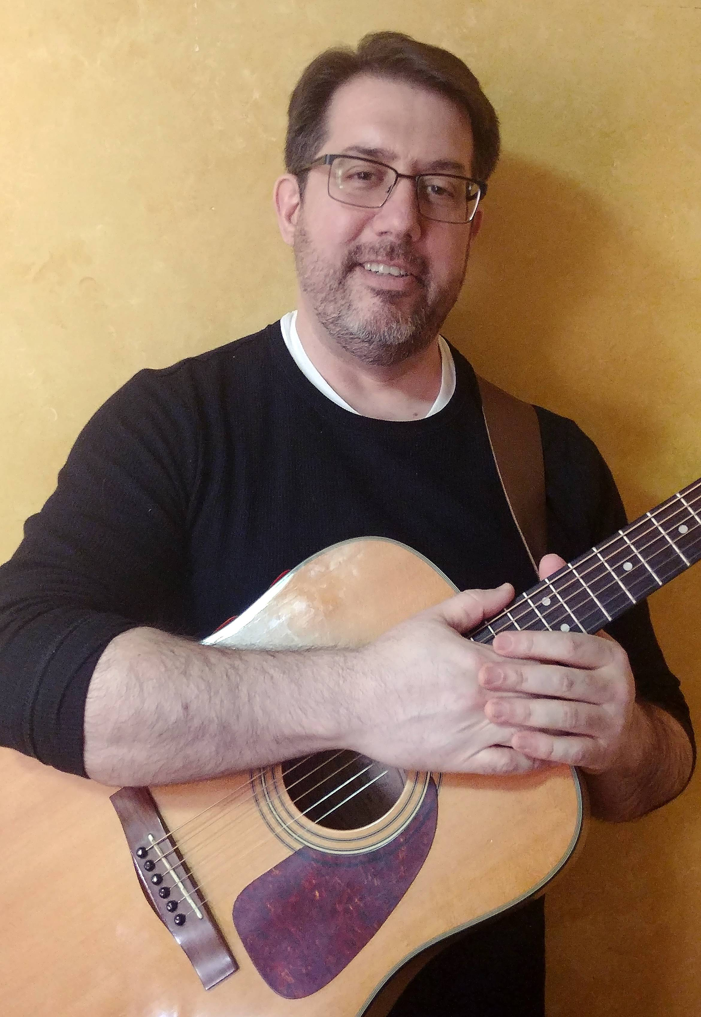 Chuck DiPietro of Batavia is fighting colon and liver cancer, and coping by creating a music support group at the LivingWell Cancer Resource Center in Geneva.